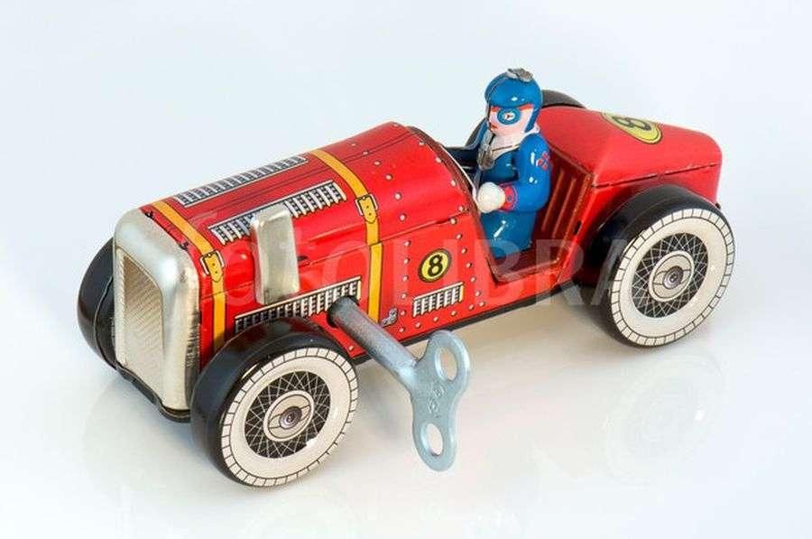 Old clockwork toy racing car.