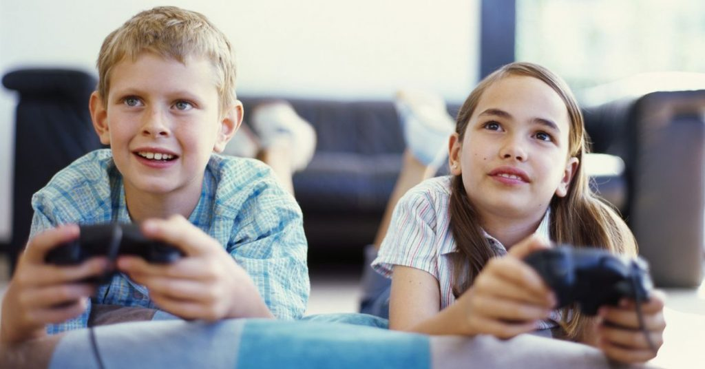 boy and a girl playing video game